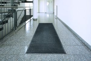 A long Morland Access Duo Door Matting in a stair lobby location