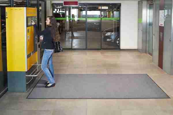 Morland Access Duo door mat by a car park pay machine