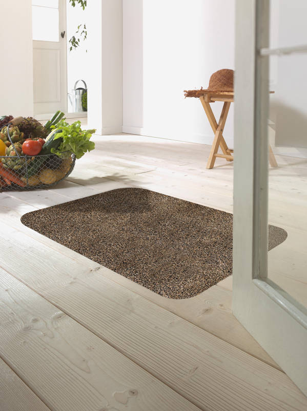 Morland cotton doormat in colour coffee on on a wooden floor in a bright room