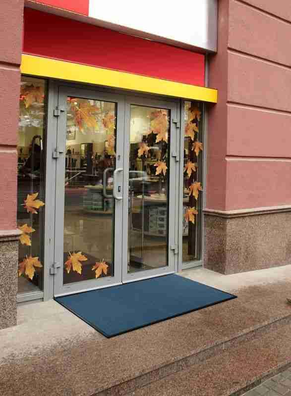 Morland Access Aqua doormat out side a shop doorway