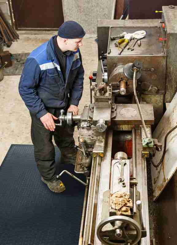 Man at a lathe standing on Morland Access Approach Industrial Rubber Matting