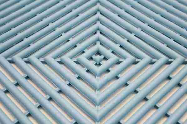 a close up morland Aqua Step Tile Changing Room Matting in colour pastel blue