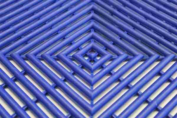 a close up morland Aqua Step Tile Changing Room Matting in colour dark blue