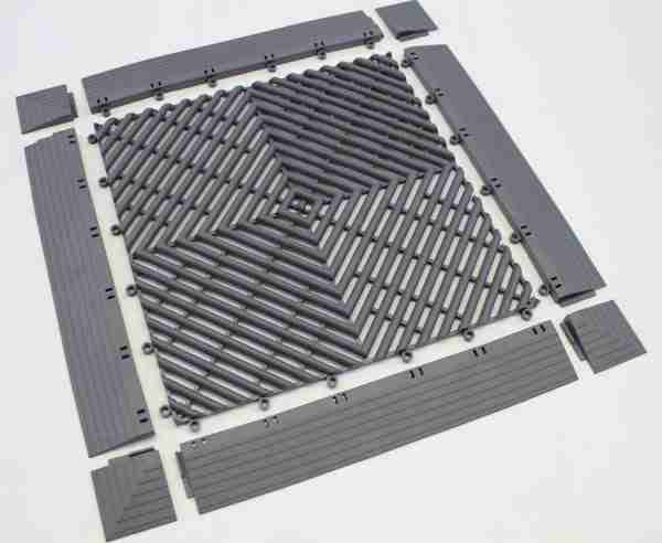 A single piece of Morland Aqua Step Tile laid out with four ramped edge pieces and four mitered corner pieces showing how they fit together in colour graphite