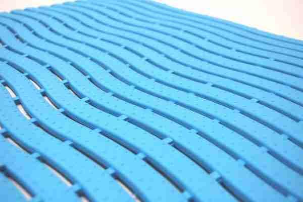 A close up of a Morland Aqua Wave tile pool matting in colour Pastel blue