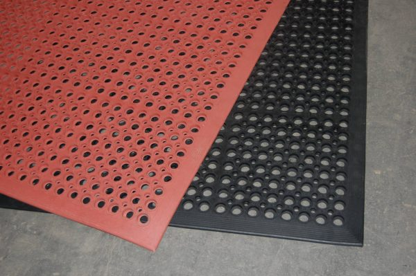 a black and a red Morland Industrial Rubber Doormat laid with the red mat at an angle on top of the black mat